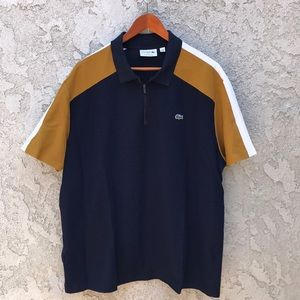 A men's navy mustard yellow and white polo shirt